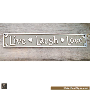 Live Laugh Love plaque with hearts. Aluminum sign - tan background. 10 inches long.