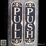 PUSH /PULL ornate bronze door signs.
