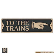 To The Trains bronze sign w/right pointing hand