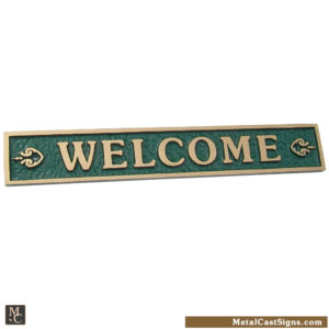 welcome sign - cast bronze w/green background
